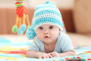 infant daycare program with cute infant in warm hat
