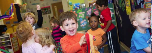 a group of Columbus Ohio preschool kids playing at a preschool